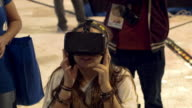 People check out the Oculus virtual reality headgear on display at the TigerDirect Tech Bash at the Miami Marlins Park