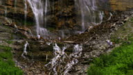 People climbing at the base of Bridal Veil Falls in Provo, Utah.