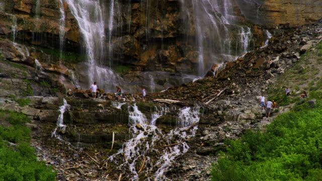 People climbing at the base of Bridal Veil Falls in Provo, Utah.