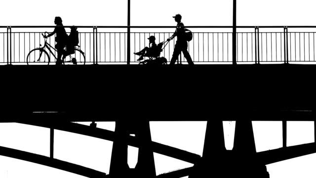 People Crossing a Bridge BW