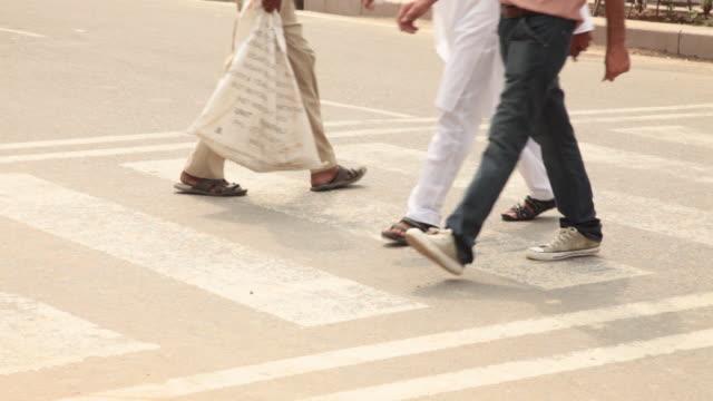 People crossing crosswalk