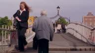 People crossing over Ha'Penny Bridge / Dublin, Ireland