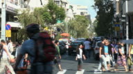 MS People crossing street on crosswalk / Tel Aviv, Israel