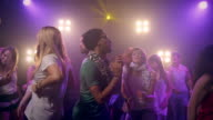 People dacing in disco