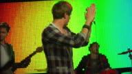MS TU TD SLO MO People dancing at rock concert / London, UK