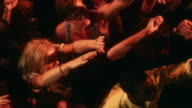 MS PAN SLO MO People dancing with arms up at nightclub / New York City, New York, USA