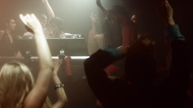 MS PAN SLO MO People dancing with DJ at nightclub / New York City, New York, USA