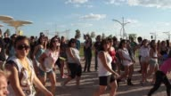 People dancing Zumba at Rock In Río Atmosphere Rock In Rio day 1 on June 30 2012 in Arganda del Rey Spain