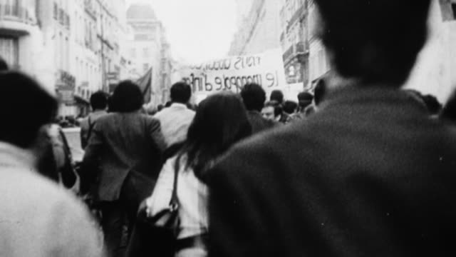 MS, B&W, People demonstrating on street, rear view, Europe
