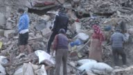 People dig out and recover property from a destroyed homes / A major earthquake hit Kathmandu midday on Saturday April 25 and was followed by...