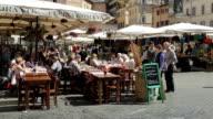 People dining in Campo de' Fiori in Rome, Italy.