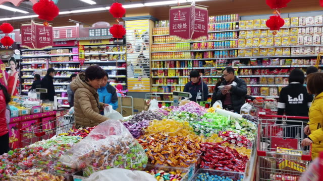 People do the shopping before The Chinese Lunar New Year Spring Festival as families gather to celebrate the forthcoming Chinese Spring Festival on...