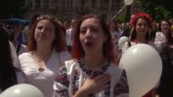 People dressed in vyshyvankas with traditional embroideries attend the 'March in vyshyvankas' in Kiev Ukraine on May 27 2017 Vyshyvanka is the Slavic...