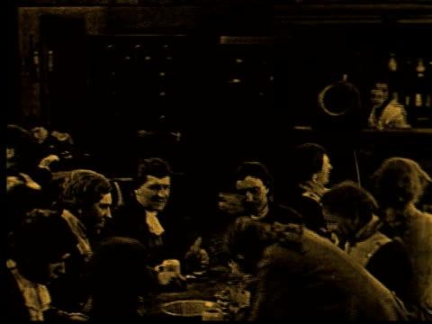 MS, B/W, People drinking in tavern, USA