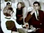 MS People drinking wine, tea and cold water in airplane, Portugal / AUDIO