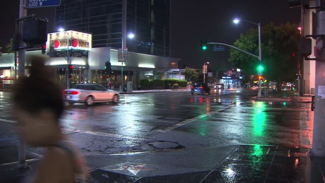 People Driving and Walking in the Rain in Hollywood California on July 22 2013 in Hollywood California