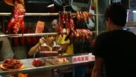 People eat dinner at the the Chinatown Hawker Market on February 20 2013 in Singapore Hawker markets are open air complexes of inexpensive cooked...