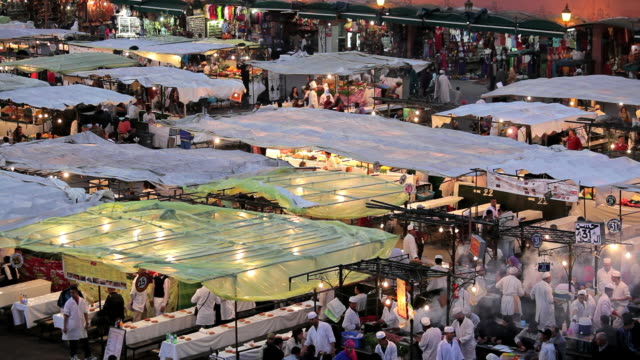 People eating at the famous food Stalls in the Djemma El- Fna Square, Marrakech, Morocco, Africa