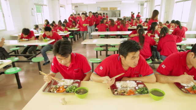 WS PAN People eating lunch at corporate cafeteria / Shenzhen, Guangdong, China