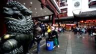 People eating snacks in the famous Chenghuang Miao Old Street,Shanghai, China