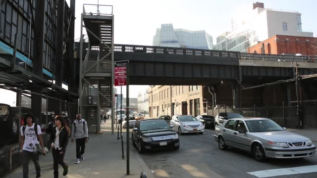 People enjoy spring weather at the High Line public park built on an historic freight rail line elevated above the streets of Manhattans West Side...