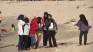 People enjoy the beach at Lhok Nga Aceh Indonesia