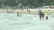 People enjoy the beach in Hua Hin a day after a series of coordinated blasts across Southern Thailand This includes Hua Hin and Phuket killing at...