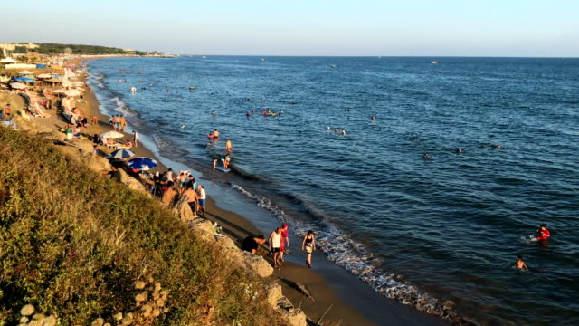 People enjoy the beach on September 3 2017 in Side Turkey Turkey's tourism industry spiralled into crisis in 2016 after a year of terrorist attacks...