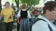 POV People enjoying beer at beer garden, Viktualienmarkt, Munich, Bavaria, Germany