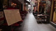 MS People enjoying café and restaurant culture in city lane / Melbourne, Victoria, Australia