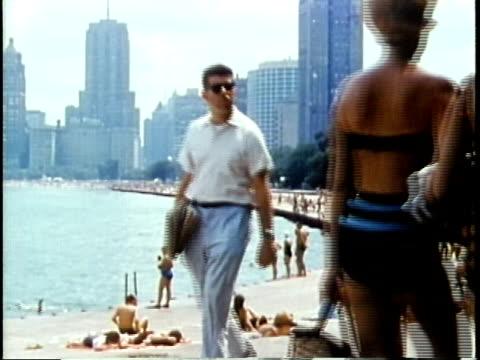 1963 MONTAGE People enjoying city beach / Chicago, United States / AUDIO
