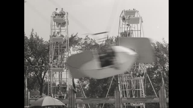 WS People enjoying fairground ride / United States