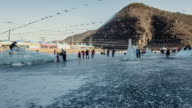WS T/L People enjoying ice festival and mountain in distance / Andong, Gyeongsangbukdo, South Korea