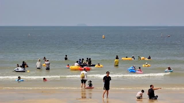 MS People enjoying summer holiday on Daechoen Beach / Boryeong, Chungcheongnam-do, South Korea