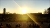 People enjoying the sunset in Jardin du Luxembourg in Paris France Created in the 17th century the Jardin du Luxembourg is famous for the Medici...