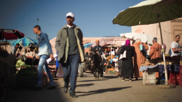 People enter the souks coming from the market.