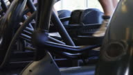 CU DS People exercising on elliptical machine in gym, low section / Draper, Utah, USA