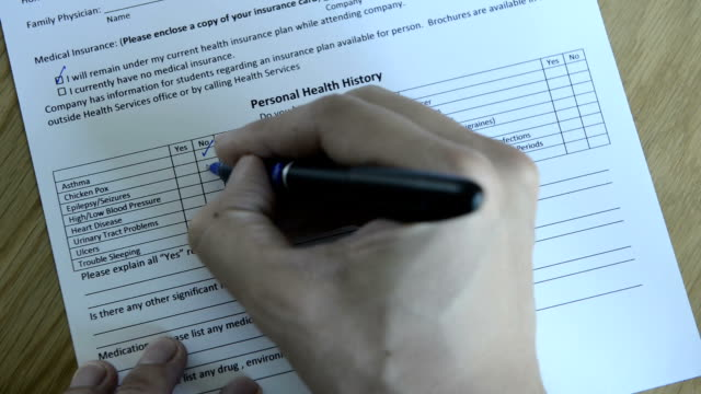 CNGLMED545 - People filling out generic healthcare insurance forms.