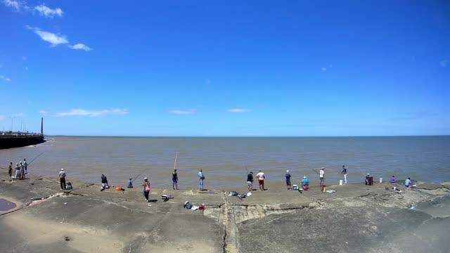 People fishing in 'Escollera Sarandí', Montevideo, Uruguay, 2015