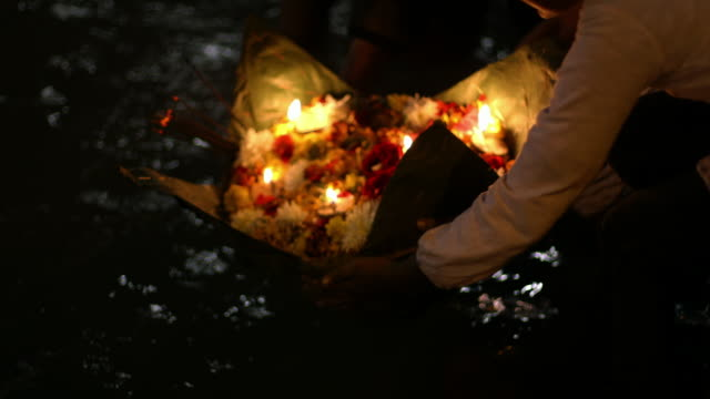 People float a floral tribute on the Ganges River during a Hindu ceremony in the city of Haridwar.