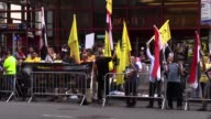 People gather at New York's Times Square on August 13 2017 to mark the fourth anniversary of Rabaa massacre in which hundreds of protestors were...