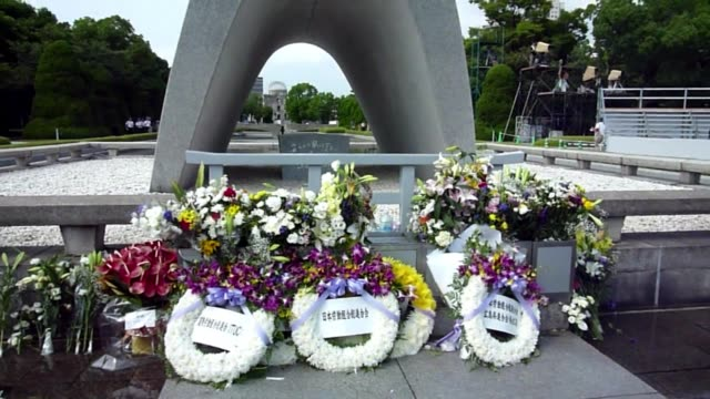 People gather at the Peace Memoral Park in Hiroshima to remember victims 68 years after atomic bombing of the Japanese city CLEAN People gather to...