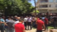 People gather at the site of an explosion in Suruc district of Sanliurfa Turkey on July 20 2015 Casualties reported after an explosion in...