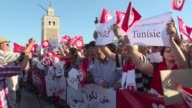 People gather for a rally in Tunis to show their support for the government in its anticorruption crackdown