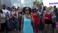 People gather in front of the Emanuel AME Church to pay respect to the nine shooting victims on June 20 in Charleston South Carolina USA Footage by...