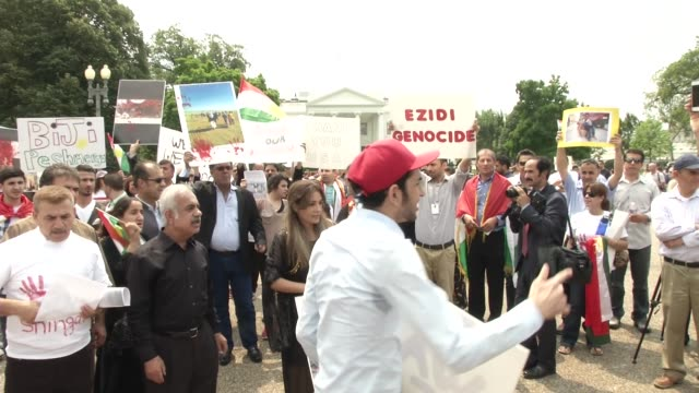 People gather in front of the White House to protest ISIS and praise the USA after US air stikes on ISIS positions in Iraq helped the Yazidi...