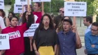 People gather in Los Angeles to protest Donald Trumps announcement that he is ending the amnesty program that protects 800000 people brought to the...