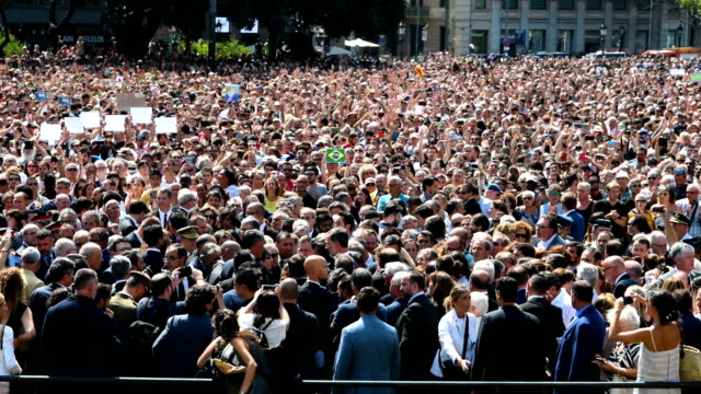 People gather in Placa de Catalunya to observe a one minute's silence for the victims of yesterday's terrorist attack on August 18 2017 in Barcelona...