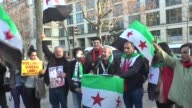 People gather to protest Assad regime forces' and its supporters' attacks on civilians and the humanitarian plight in front of Iranian Embassy in...