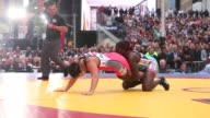 People gather to watch Square wrestling match between USA Wrestling and Cuban National Team in support of Beat The Streets in Times Square in New...